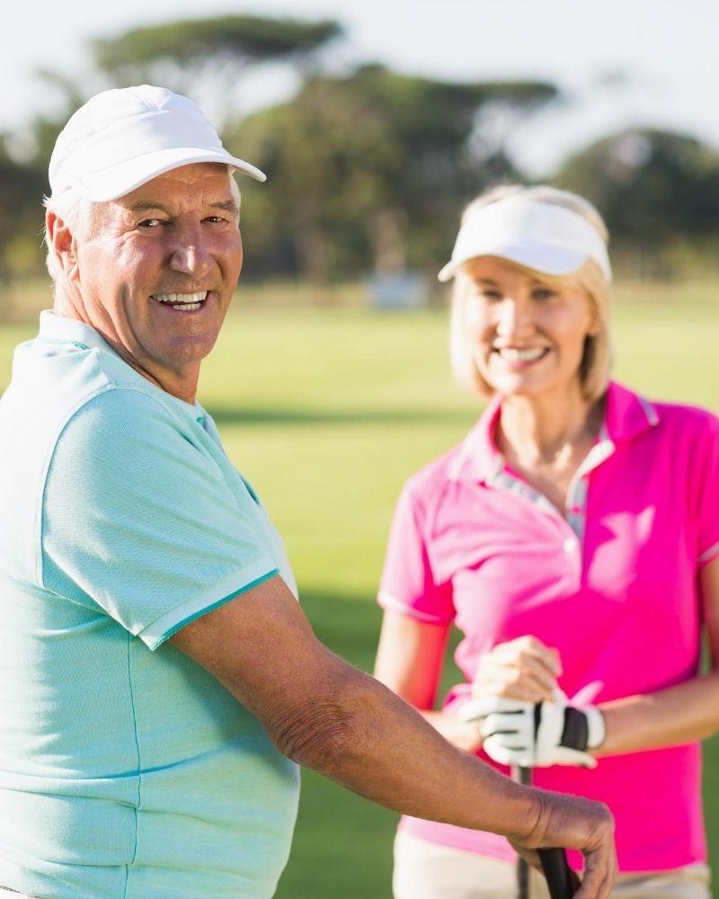 mature couple golfing